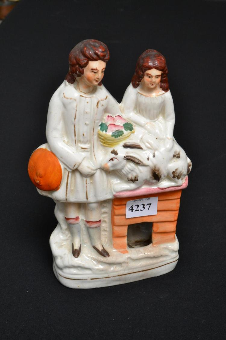 A STAFFORDSHIRE FIGURAL GROUP (DAMAGES)