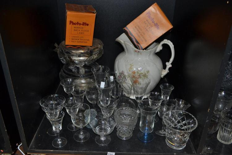 A SHELF OF ASSORTED ITEMS INCL. ETCHED STEMWARE, A CHAMBER JUG, ETC.