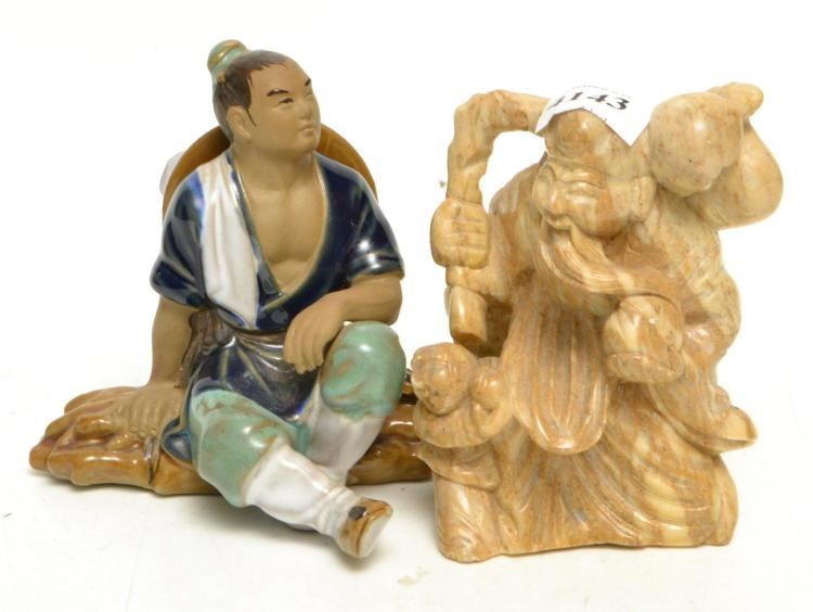 TWO CHINESE FIGURINES, ONE STONE CARVED SHOULAO, ONE POTTERY YOUNG MAN, TALLEST 10 CM (REPAIRED)
