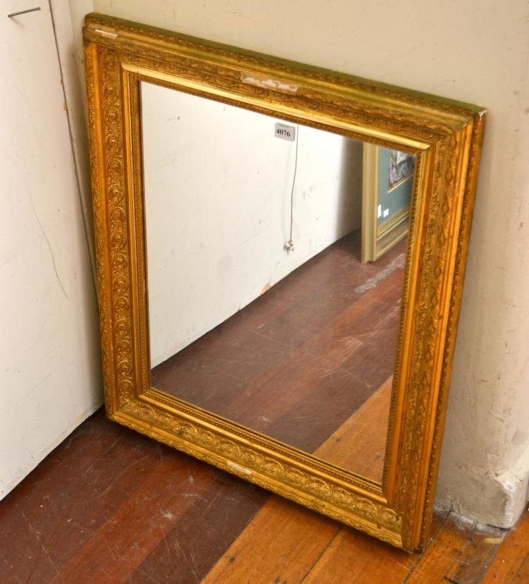 A GILT FRAMED MIRROR (ALL FAULTS)