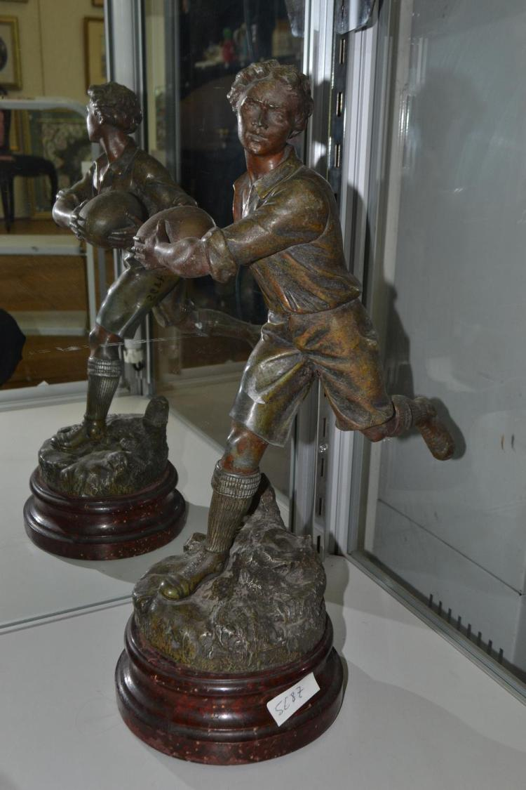 A SPELTER FIGURE OF A FOOTBALLER