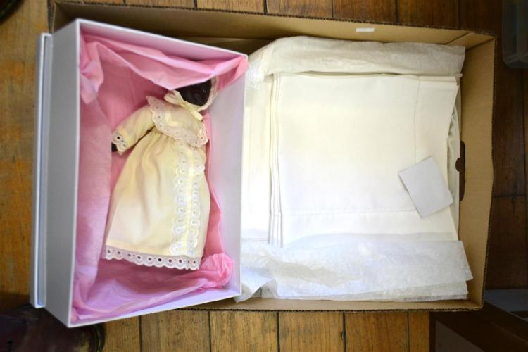 A BOX OF HAND STITCHED IRISH AND ITALIAN LACE AND A DOLL