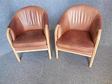 PAIR OF MOGENS HANSEN (DANISH, BORN 1940) BROWN LEATHER ARMCHAIRS