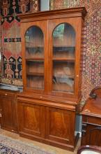 A VICTORIAN MAHOGANY BOOKCASE WITH TWIN DOME GLASS DOORS AND ADJUSTABLE SHELVES (keys in office) h240 x w130 x d50cm