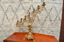 A HIGHLY DETAILED SEVEN TIER BRONZE CANDELABRA