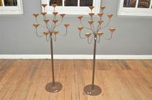 A PAIR OF UNIQUE POLISH MADE TWISTED IRON AND COPPER TALL STANDING CANDELABRAS