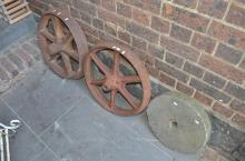 TWO VINTAGE AGRICULTURAL MACHINERY WHEELS AND ONE VINTAGE SHOPPING STONE WHEEL