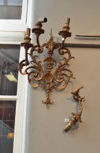 A FOUR BRANCH BRONZE WALL SCONCE (WITH BREAKS TO ONE)