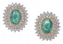 A PAIR OF EMERALD AND DIAMOND STUD EARRINGS