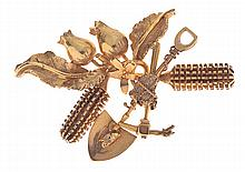 A GOLD MINER'S BROOCH
