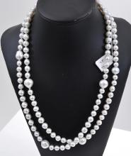 A LONG STRAND OF BAROQUE SOUTH SEA PEARLS