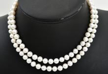 A LONG STRAND OF FRESH WATER PEARLS TO A SILVER CLASP