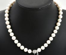 A STRAND OF FRESH WATER PEARLS TO A MAGNETIC CLASP