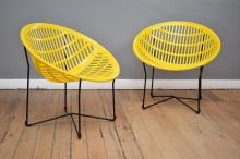 A PAIR OF YELLOW SOLAIR CHAIRS