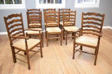 A SET OF EIGHT FRENCH PROVINCIAL STYLE LADDERBACK DINING CHAIRS INCLUDING TWO CARVERS (some with structural faults)