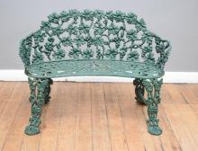A VICTORIAN LILLEY OF THE VALLEY PAINTED CAST IRON GARDEN BENCH