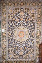 A ROYAL BLUE KASHAN; SUNBURST MEDALLION, 100% WOOL, DENSE PILE, VERY HARD WEARING; NEW RUG, ORIGIN- IRAN. 343 X 225CM. RRP $7900