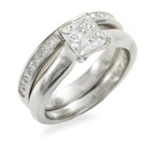 A SOLITAIRE DIAMOND RING AND BAND