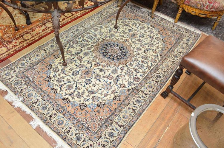 A Persian Nain Wool And Silk Hand Knotted Low Pile Carpet I