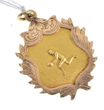 AN AUSTRALIAN CFC FOOTBALL MEDALLION 1926, BY WILLIS AND CO, IN 9CT GOLD