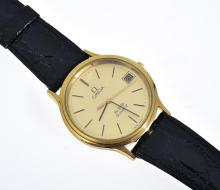 AN OMEGA DEVILLE WRISTWATCH WITH QUARTZ MOVEMENT, CIRCULAR GILDED DIAL WITH BATON NUMERALS AND DATE AT THREE, SIGNED CASE, DIAL AND...