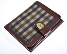 A WALLET BY AQUASCUTUM OF LONDON, STYLED IN TARTAN CANVAS WITH A LEATHER TRIM, 9 X 12CM.