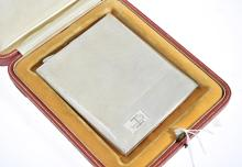 A STERLING SILVER CIGARETTE CASE HALLMARKED BIRMINGHAM 1921, PRESENTED IN A VINTAGE CARTIER BOX ACCOMPANIED BY PHOTOGRAPHIC MEMORABI...
