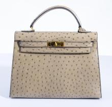 AN OSTRICH KELLY BAG BY HERMES