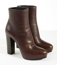 A PAIR OF HEELED BOOTS BY PRADA