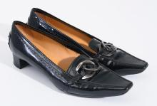 A PAIR OF COURT SHOES BY TODS
