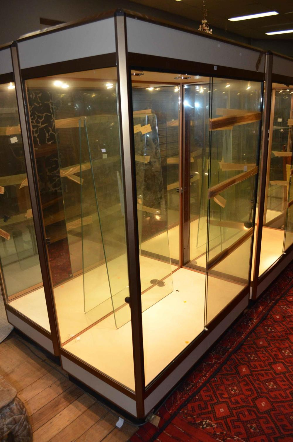 a large twin door mirror back display cabinet with lighting. Black Bedroom Furniture Sets. Home Design Ideas