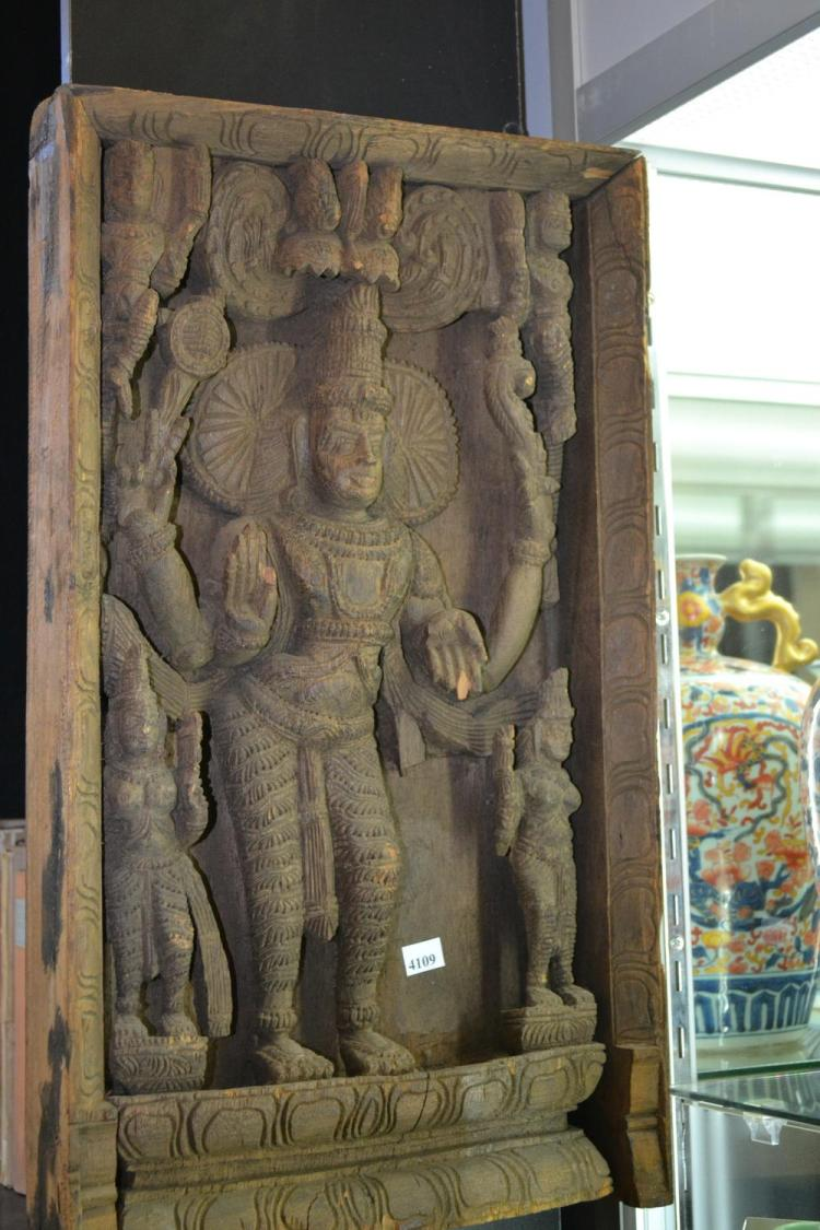 An indian carved architectural panel in relief