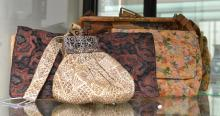 A COLLECTION OF WOVEN LADIES VINTAGE BAGS AND CLUTCHES INCL. FILIGREE AND SNAKESKIN CLASPS. ONE WITH GEOMETRIC METALLIC BROCADE