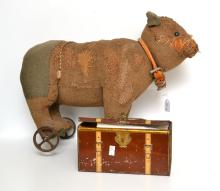 AN EDWARDIAN STEIFF BEAR ON WHEELS AND ASSOCIATED TRUNK AND PROVENANCE WITH LETTER OF THE BEAR''S HISTORY (WELL LOVED)