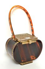 A TYROLEAN LUCITE BAG FROM NEW YORK; 1950, BROWN METAL TOP, SOME DAMAGE TO BOTTOM