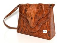 AN ALLIGATOR BAG WITH FULL PELT OF LEGS AND HEAD, C.1950
