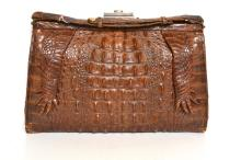 A 1930''S ALLIGATOR SKIN BAG WITH LEGS, SUEDE LINING