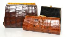 THREE CLUTCH BAGS FROM THE 1930''S-ONWARDS INCL. BLACK LEATHER, BROWN LEATHER AND CROCODILE