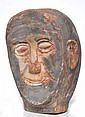 * ARTIST UNKNOWN Untitled (Head of Ancestral Figure) natural earth pigments on carved sandstone