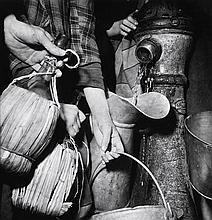 MARGARET BOURKE-WHITE (AMERICAN, 1904-1971) Collecting Water, Naples 1943 silver gelatin print
