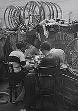 BRASSAI (GYULA HALASZ) (HUNGARIAN-FRENCH, 1899-1984) Untitled (Eating at the Velodrome), circa 1932 silver gelatin print