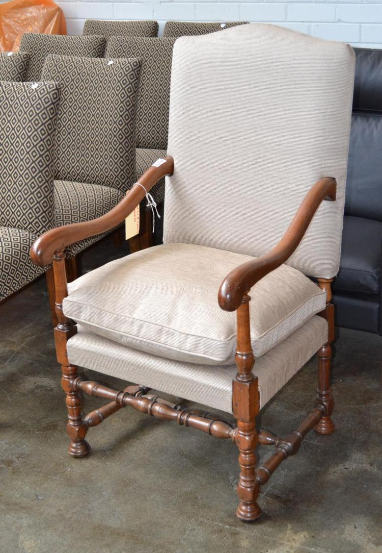 a louis xv style fauteuil covered in upholstery