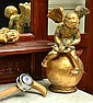 GILDED CUPID MOUNTED ON A GLOBE TOGETHER WITH 2 WALKING STICKS