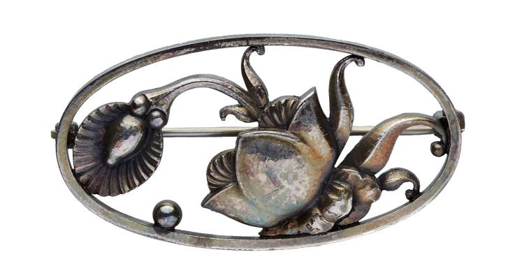 A GEORG JENSEN LOTUS FLOWER AND LILY BROOCH BY GUNDORPH ALBERTUS, CIRCA 1960
