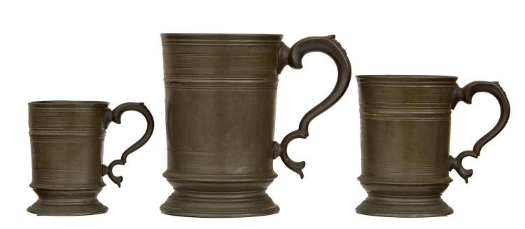 A GRADUTATED SET OF THREE PEWTER STRAIGHT SIDE MUGS