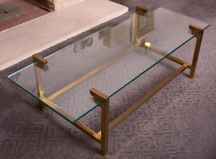 A BRASS MOUNTED COFFEE TABLE IN THE MANNER OF MAISON JENSEN