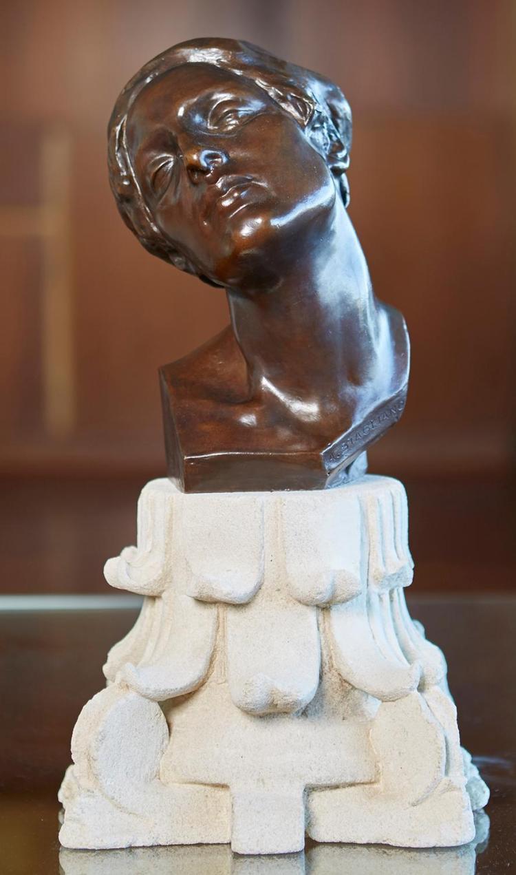 AFTER ARTURO STAGLIANO (Italian, 1870-1936) Woman''s Head bronze on sandstone base