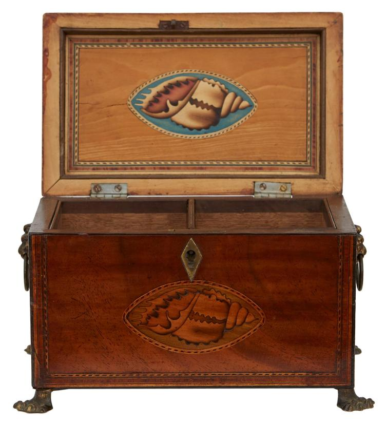 A REGENCY MAHOGANY TEA CADDY WITH MARQUETRY AND BRASS FITTINGS