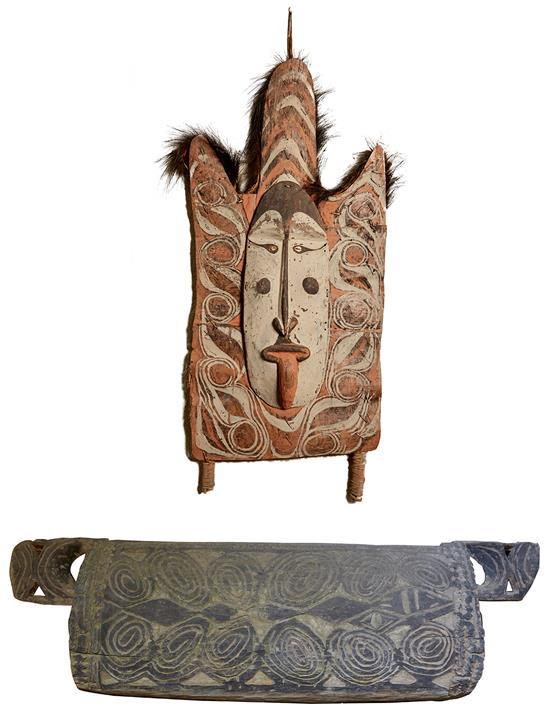 A CARVED OLD GARAMUT SHIELD DRUM & A CANOE SHIELD MASK, MIDDLE AND LOWER SEPIK RIVER, PAPUA NEW GUINEA