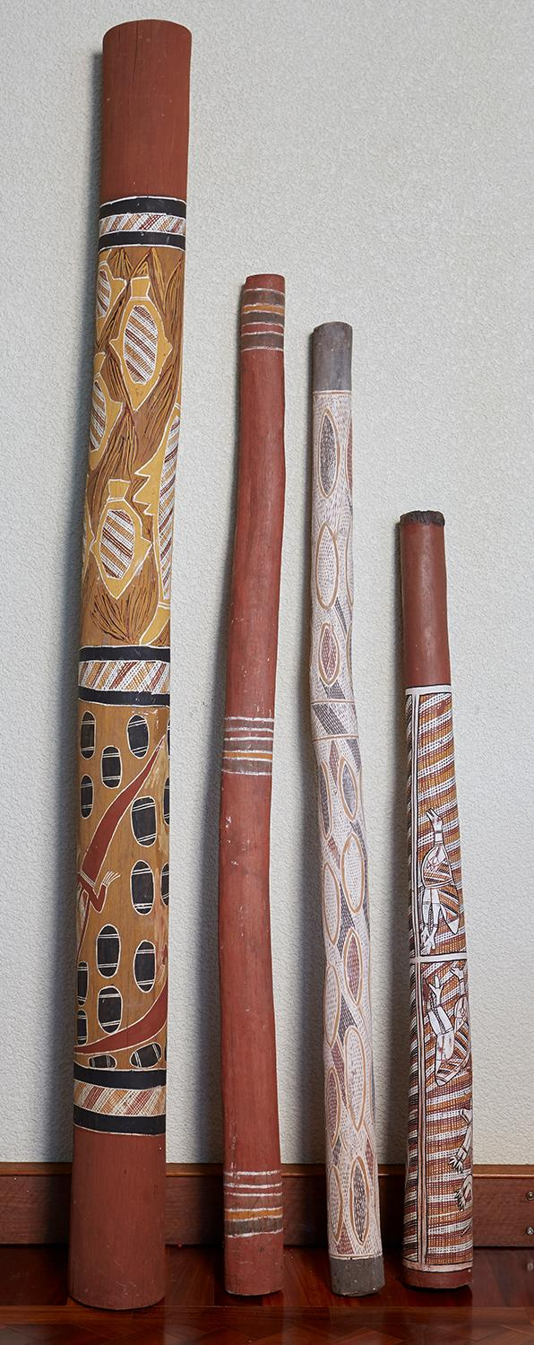 FOUR FINELY PAINTED HOLLOW LOGS AND DIDGERIDOOS, ARNHEM LAND, NORTHERN TERRITORY